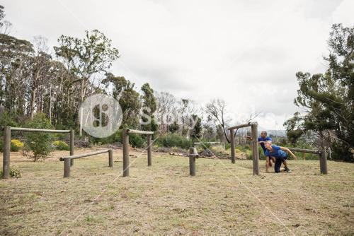 People passing through hurdles during obstacle course