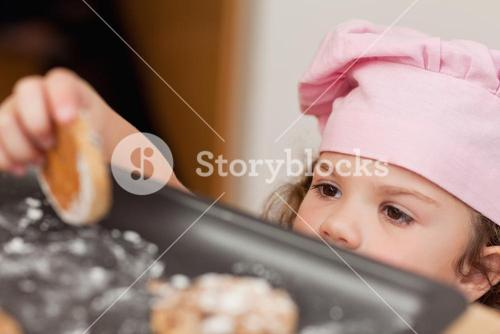 Girl stealing a cookie