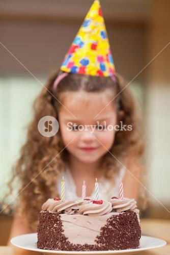 Slice of cake about to be eaten by girl