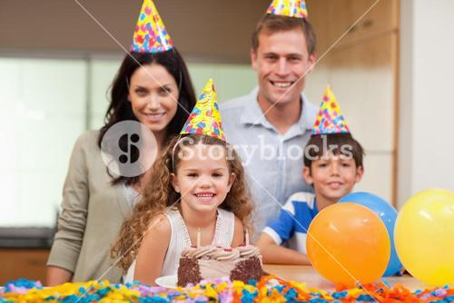 Smiling family celebrating birthday