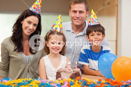 Smiling family celebrating daughters birthday