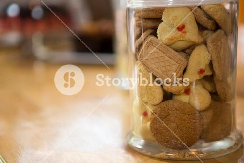 Cookies in jar on counter at coffee shop