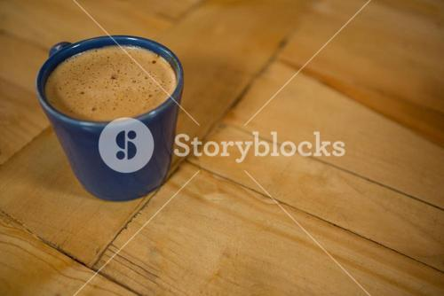 Coffee cup on table in cafeteria