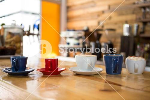 Coffee cups on table in cafeteria
