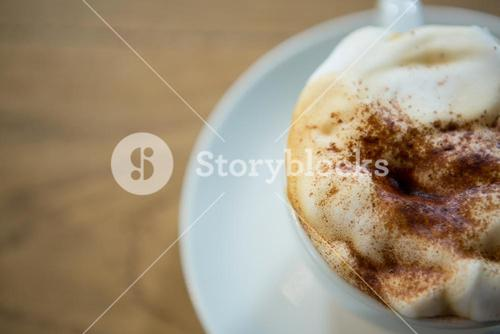 Overhead shot of coffee cup with creamy froth