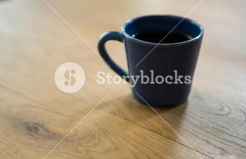 Coffee cup on wooden table in cafe