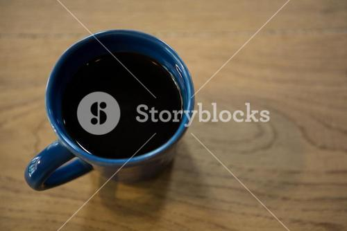 Cup of coffee on table in cafeteria