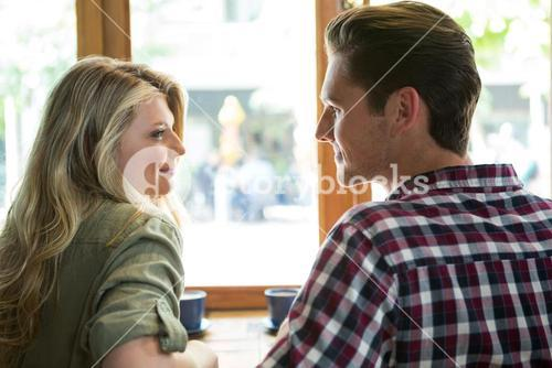 Loving couple looking at each other in coffee house