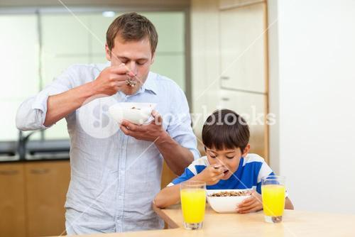 Father and son having cereals