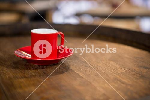 Close-up of red cup and saucer on table