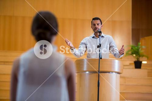 Business executive interacting with audience