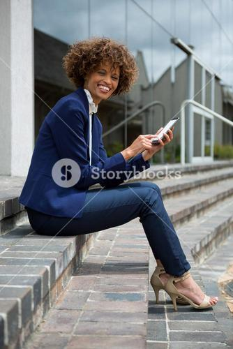 Businesswoman using mobile phone in the premises