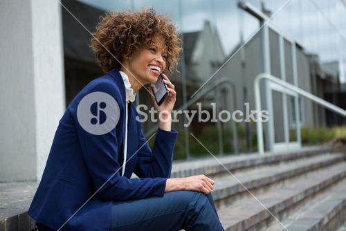 Businesswoman talking on mobile phone in the premises