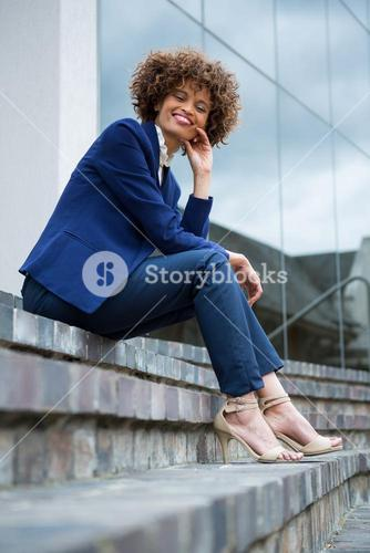 Smiling businesswoman sitting in the premises