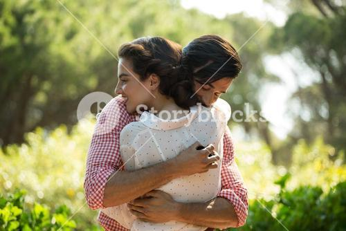 Affectionate couple embracing at park