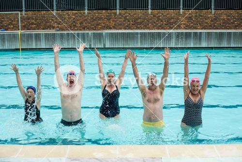 Carefree senior swimmers enjoying in pool