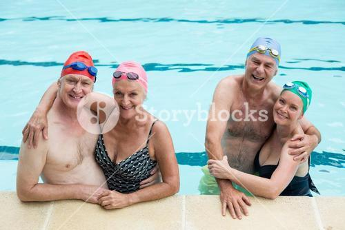 Senior couples enjoying in pool