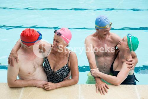 Happy senior couples enjoying in pool
