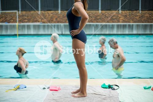 Swimmers following female trainer