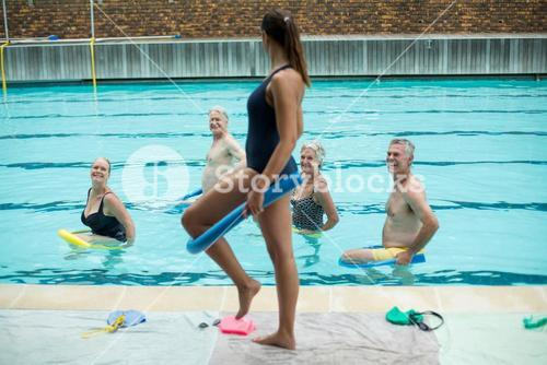 Female trainer demonstrating use of pool noodle