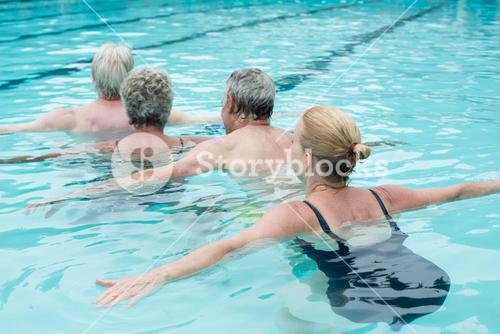 Row of swimmers swimming in pool