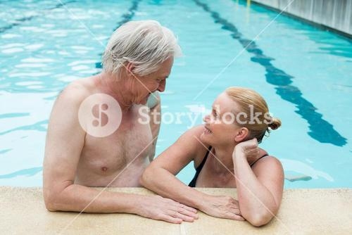 Couple looking at each other at poolside