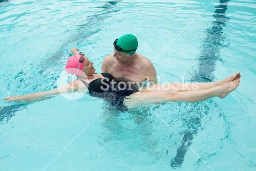 Loving couple enjoying in swimming pool