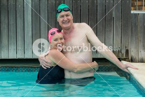 Mature couple embracing in swimming pool