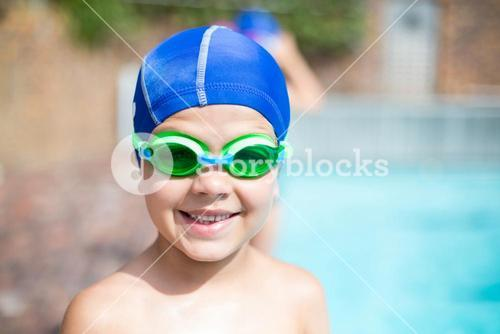 Little boy wearing swimming goggle and cap