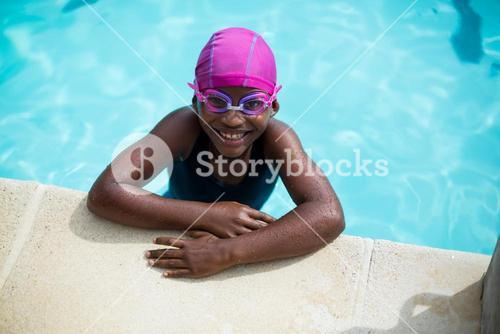 Little girl leaning at poolside