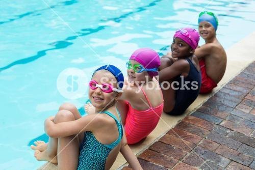 Portrait of little swimmers at poolside