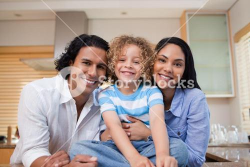 Cheerful family together in the kitchen
