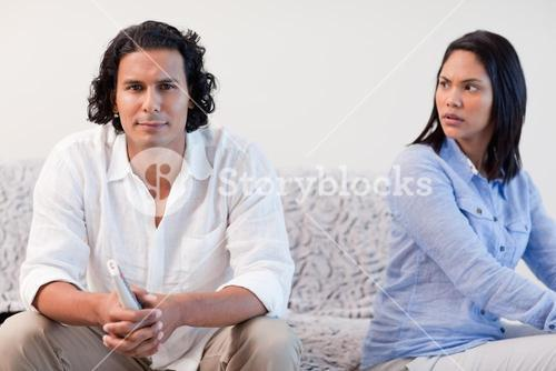 Couple having a dispute in the living room