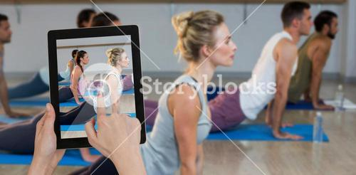 Composite image of hands touching digital tablet against white background