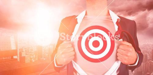 Businessman opening shirt with sports target