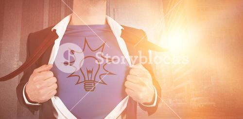 Digital composite image of businessman opening his shirt superhero style