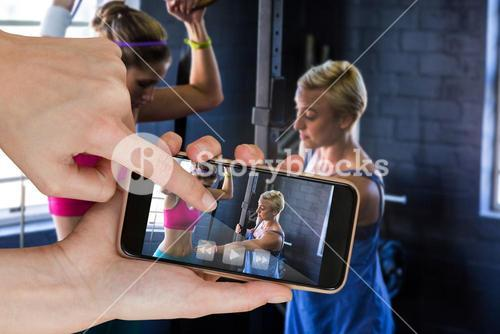 Composite image of female trainer instructing woman in gym
