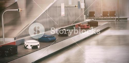 Luggage passing through baggage claim
