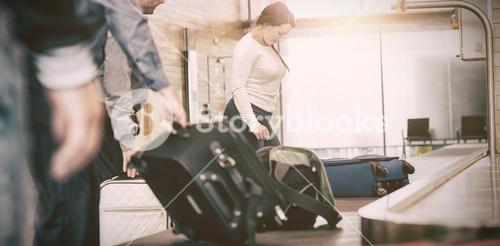 People carrying luggage from baggage claim