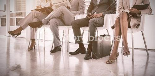 Business people sitting in waiting room