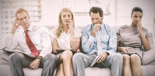 Nervous executives waiting for interview