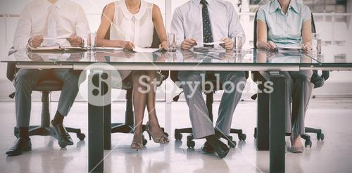 Group of business people sitting at table