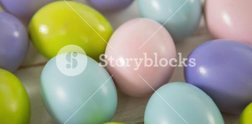 Multicolored Easter eggs on wooden surface