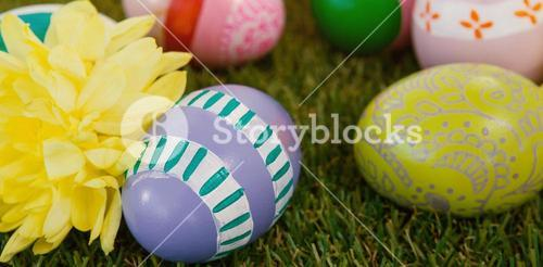 Painted easter eggs with flowers on grass