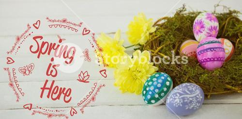 Composite image of spring is here logo against background