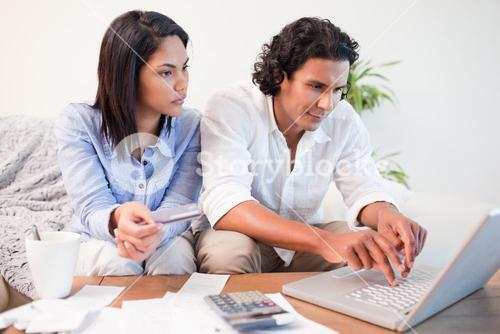 Couple checking their bank accounts online