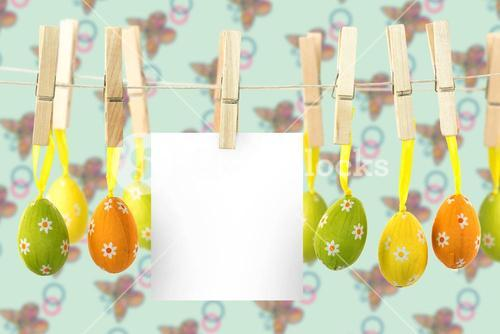 Composite image of hanging easter eggs