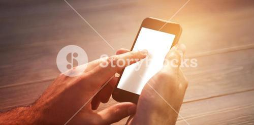Cropped image of person using mobile phone