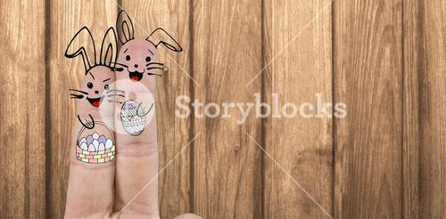 Composite image of illustration of fingers representing easter bunny