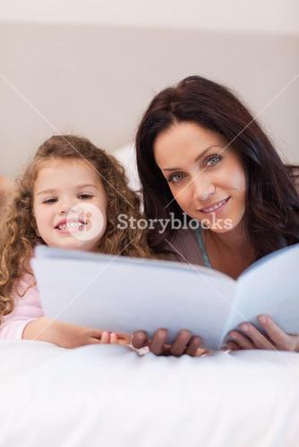 Mother and daughter reading bedtime stories together